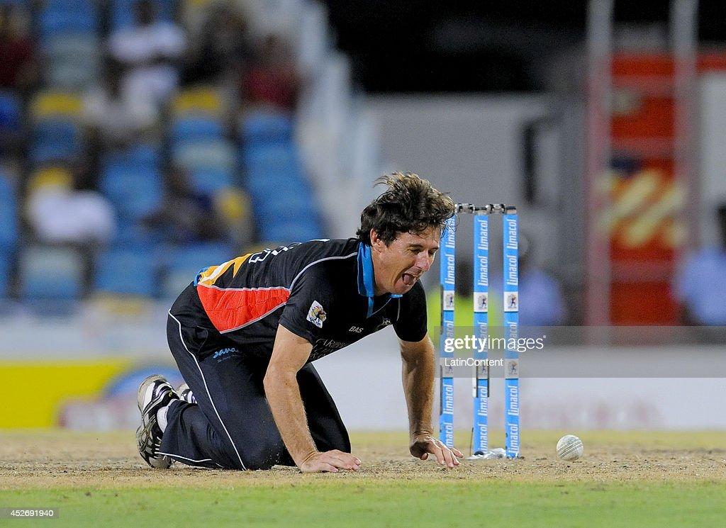 Bradley Hogg of Antigua Hawksbills attempts to run out Akeal Hosein of Barbados Tridents during a match between Barbados Tridents and Antigua Hawksbills as part of the week 3 of Caribbean Premier League 2014 at Kensington Oval on July 25, 2014 in Bridgetown, Barbados.