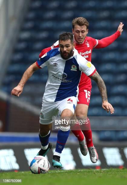 Bradley Johnson of Blackburn Rovers battles with Luke Freeman of Nottingham Forest during the Sky Bet Championship match between Blackburn Rovers and...