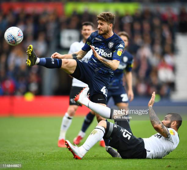Bradley Johnson of Derby County battles for possession with Mateusz Klich of Leeds United during the Sky Bet Championship Playoff semi final first...
