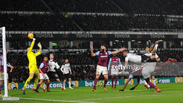 Bradley Johnson of Derby County header is saved by Sam Johnstone of Aston Villa during the Sky Bet Championship match between Derby County and Aston...