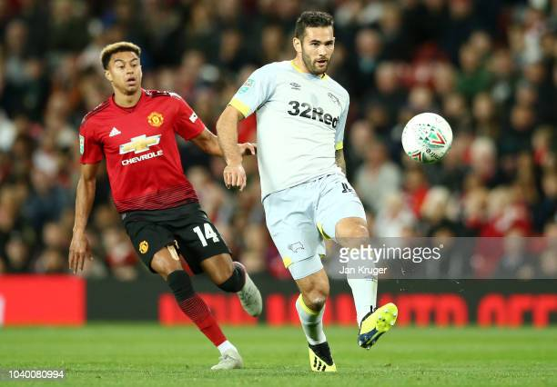 Bradley Johnson of Derby County passes the ball under pressure from Jesse Lingard of Manchester United during the Carabao Cup Third Round match...