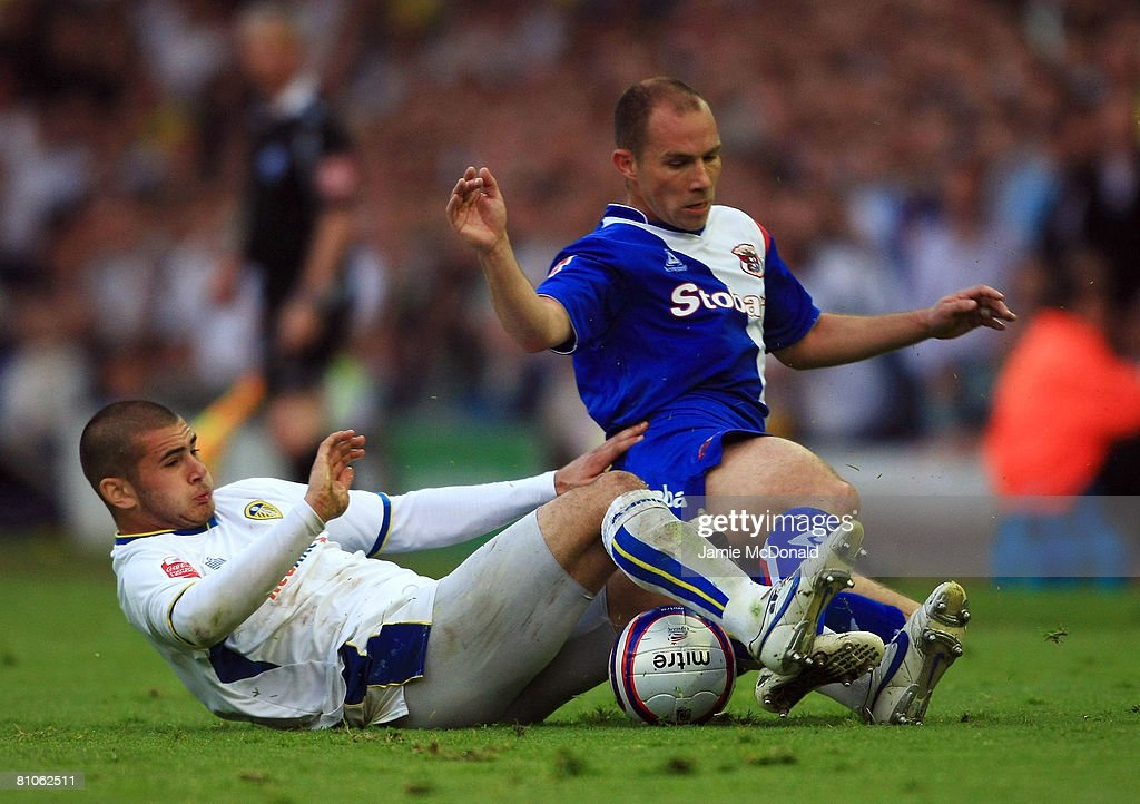 Bradley Johnson of Leeds tackles Marc Bridge Wilkinson of Carlisle during the League 1 Playoff Semi Final, 1st Leg match between Leeds United and Carlisle United at Elland Road on May 12, 2008 in Leeds, England.