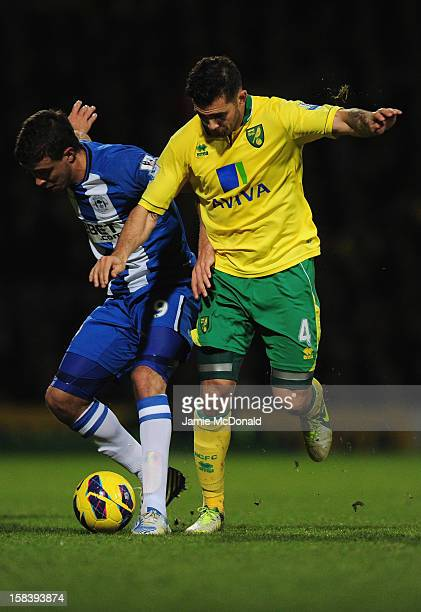 Bradley Johnson of Norwich City battles with Franco Di Santo of Wigan during the Barclays Premier League match between Norwich City and Wigan...