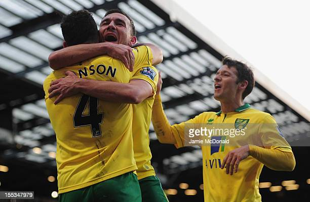 Bradley Johnson of Norwich City celebrates his goal with Robert Snodgrass during the Barclays Premier League match between Norwich City and Stoke at...