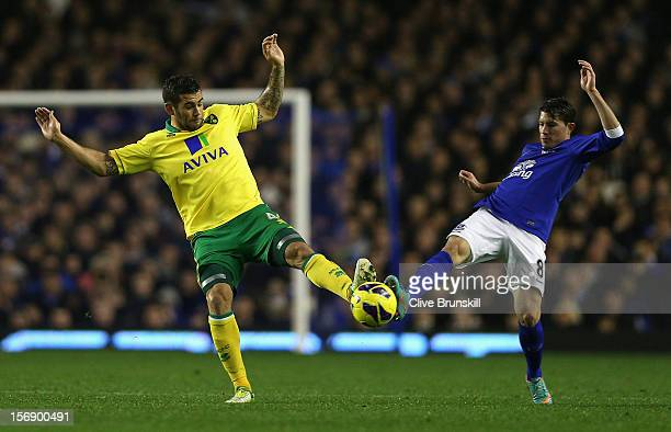 Bradley Johnson of Norwich City clashes for the ball with Bryan Oviedo of Everton during the Barclays Premier League match between Everton and...