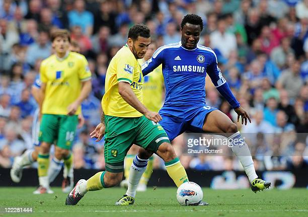 Bradley Johnson of Norwich City is closed down by Mikel of Chelsea during the Barclays Premier League match between Chelsea and Norwich City at...