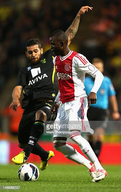 Bradley Johnson of Norwich City tangles with Jody Lukoki of Ajax during the pre-season friendly match at Carrow Road on July 31, 2012 in Norwich,...