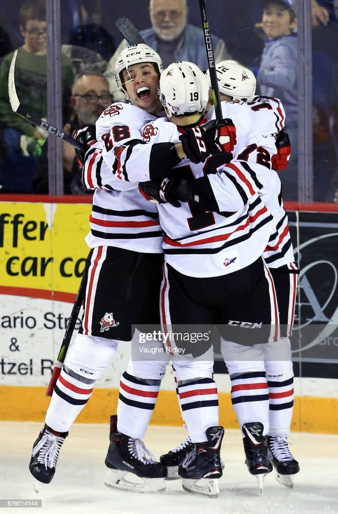 Bradley Johnson #72 of the Niagara IceDogs celebrates a goal with Andrew Bruder #28 and Ian Martin #19 during the second period of an OHL game against the Mississauga Steelheads at the Meridian Centre on November 25, 2017 in St Catharines, Ontario, Canada.