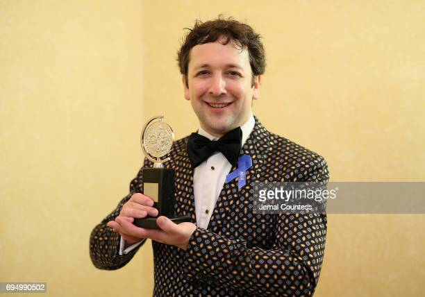 """Bradley King, winner of the award for Best Lighting Design of a Musical for """"Natasha, Pierre & The Great Comet of 1812,"""" poses in the press room..."""