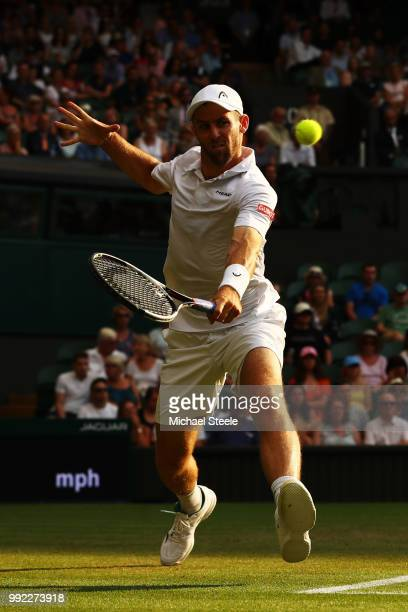 Bradley Klahn of the United States returns a shot against Kyle Edmund of Great Britain during their Men's Singles second round match on day four of...