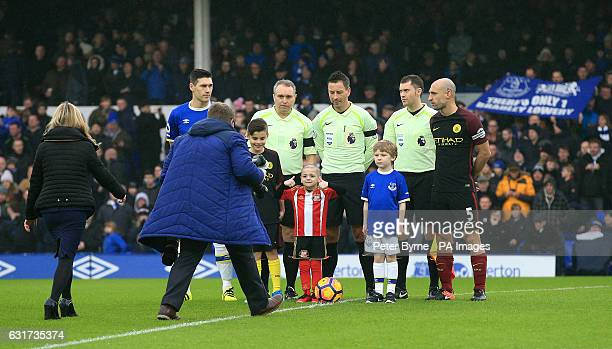 Bradley Lowery aged five who is terminally ill with cancer on to the pitch with Everton captain Gareth Barry and Manchester City captain Pablo...