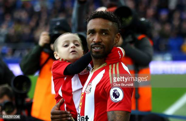 Bradley Lowery is carried out by Jermain Defoe of Sunderland prior to the Premier League match between Everton and Sunderland at Goodison Park on...