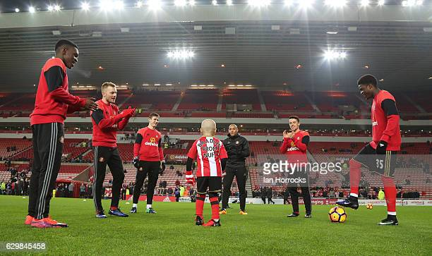 Bradley Lowery warms up with the Sunderland team during the Premier League match between Sunderland and Chelsea at Stadium of Light on December 14...