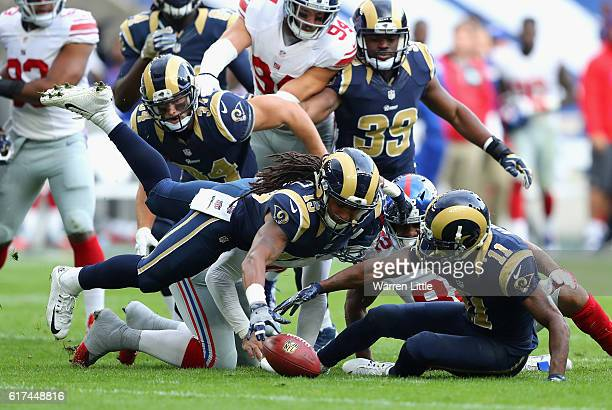 Bradley Marquez of the Los Angels Rams leaps throught eh air to recover the ball during the NFL International Series match between New York Giants...