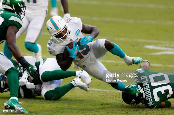 Bradley McDougald of the New York Jets tackles Jakeem Grant of the Miami Dolphins in the first half of their game at Hard Rock Stadium on October 18,...