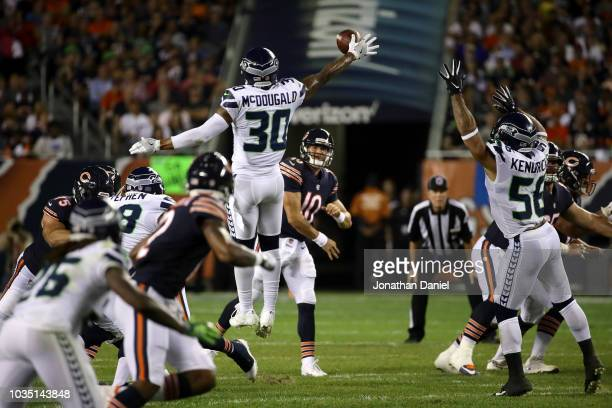 Bradley McDougald of the Seattle Seahawks blocks the pass by quarterback Mitchell Trubisky of the Chicago Bears in the first half at Soldier Field on...