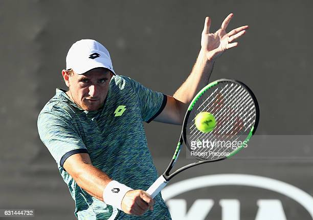 Bradley Mousley of Australia plays a backhand in his 2017 Australian Open Qualifying match against Marton Fucsovics of Hungary at Melbourne Park on...