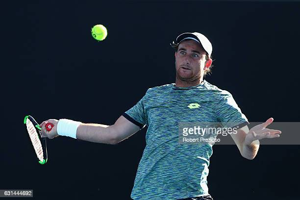 Bradley Mousley of Australia plays a forehand in his 2017 Australian Open Qualifying match against Marton Fucsovics of Hungary at Melbourne Park on...
