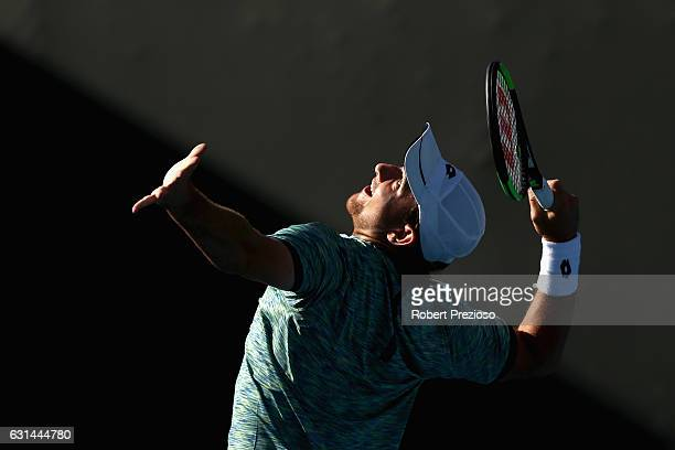 Bradley Mousley of Australia serves in his 2017 Australian Open Qualifying match against Marton Fucsovics of Hungary at Melbourne Park on January 11...