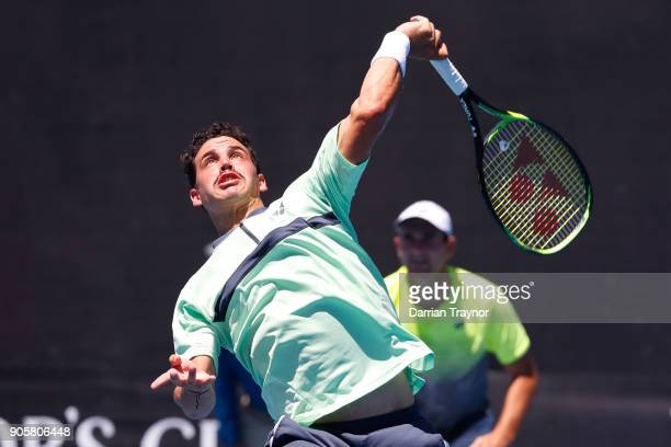Bradley Mousley of Australia serves in his first round men's doubles match with Alex Bolt of Australia against Fabio Fognini of Italy and Marcel...
