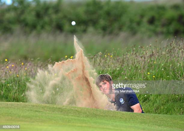 Bradley Neil of Blairgowrie chips out of a bunker during The Amateur Championship 2014 Day Five at Royal Portrush Golf Club on June 20 2014 in...
