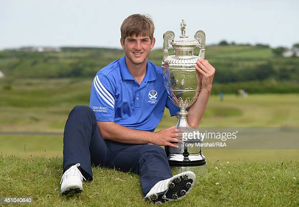 Bradley Neil of Blairgowrie with the trophy after winning the final round of The Amateur Championship 2014 Day Seven at Royal Portrush Golf Club on...