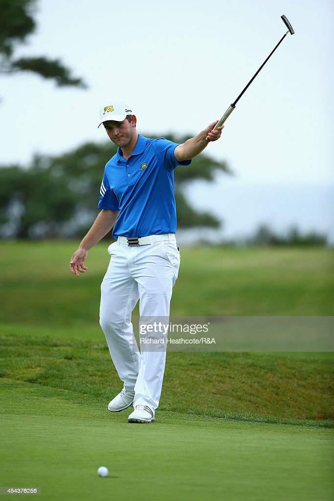Bradley Neil of GB&I celebrates as he holes the putt that seals victory over Tim Gornik of Europe and secures the trophy for GB&I during the final day of the St Andrews Trophy at Barseback Golf & Country Club on August 30, 2014 in Loddekopinge, Sweden.