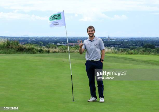 Bradley Neil of Scotland celebrates his tee shot for a hole in one on the eighth hole during the Clutch Pro Tour Major on The Downs Course at...