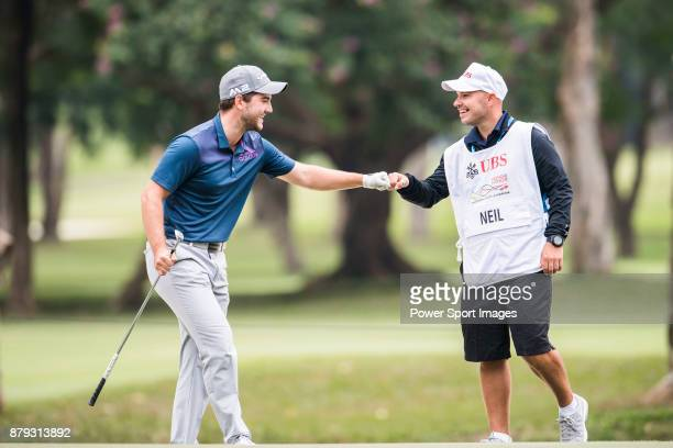 Bradley Neil of Scotland celebrates with the caddie during round four of the UBS Hong Kong Open at The Hong Kong Golf Club on November 26 2017 in...