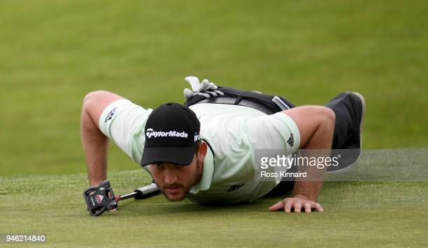 Bradley Neil of Scotland lines up his putt on the par four 16th hole during the third round of the Open de Espana at Centro Nacional de Golf on April...