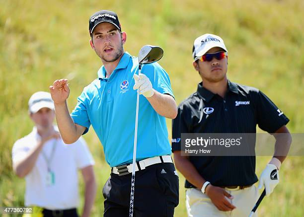 Bradley Neil of Scotland reacts as Hideki Matsuyama of Japan looks on during a practice round prior to the start of the 115th US Open Championship at...