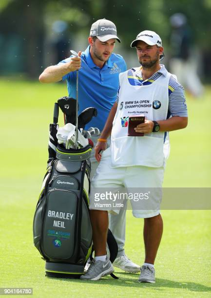 Bradley Neil of Scotland takes a club from his bag with caddie during day two of the BMW South African Open Championship at Glendower Golf Club on...