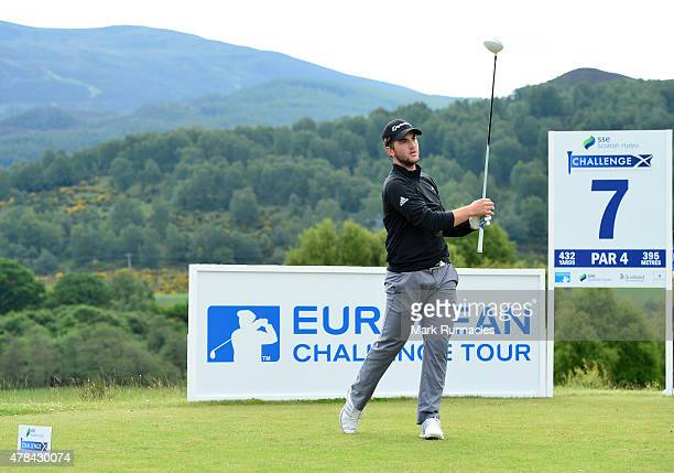 Bradley Neil of Scotland watches his drive on the 7th tee during the first round of the 2015 SSE Scottish Hydro Challenge at the MacDonald Spey...