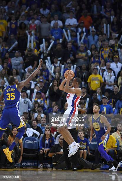 Bradley of the Detroit Pistons shoots over Kevin Durant and Stephen Curry of the Golden State Warriors during an NBA basketball game at ORACLE Arena...