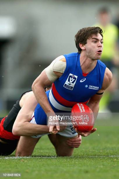 Bradley Olsson of Footscray is tackled during the round 20 VFL match between Essendon and Footscray at Windy Hill on August 18 2018 in Melbourne...