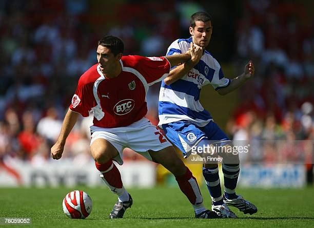 Bradley Orr of Bristol holds off Danny Nardiello of QPR during the CocaCola Championship match between Bristol City and Queens Park Rangers at Ashton...