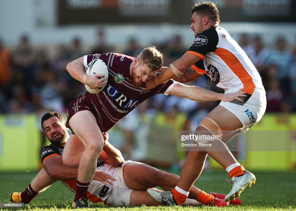 Bradley Parker of the Sea Eagles is tackled by the Tigers defence during the round six NRL match between the Manly Sea Eagles and the Wests Tigers at Lottoland on April 15, 2018 in Sydney, Australia.
