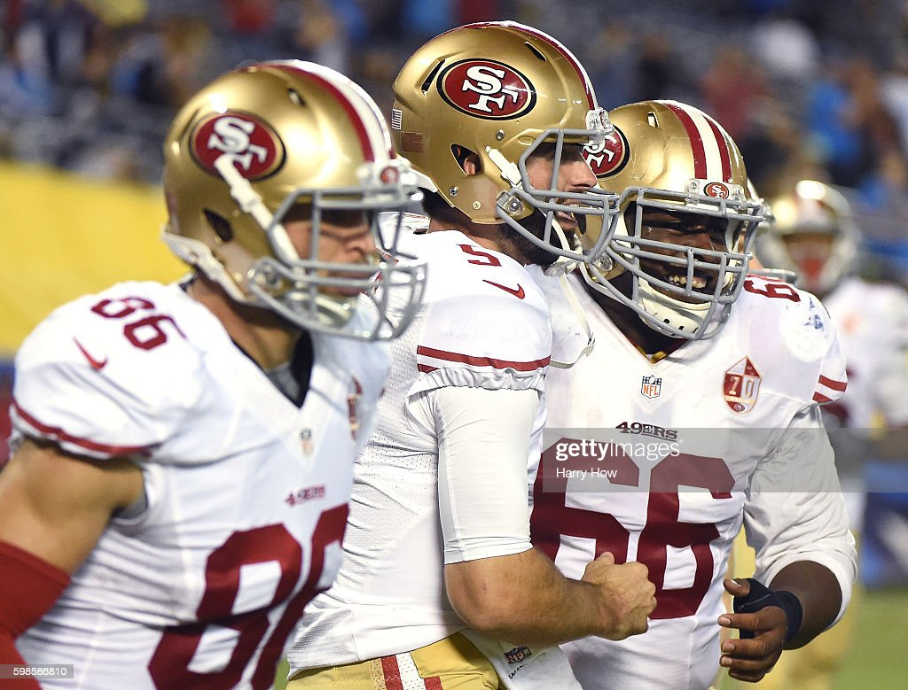 Bradley Pinion #5 of the San Francisco 49ers celebrates a touchdown with Marcus Martin #66 and Devon Cajuste #86 to take a 22-21 lead over the San Diego Chargers during a preseason game at Qualcomm Stadium on September 1, 2016 in San Diego, California.