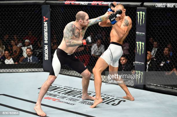 Bradley Scott of England punches Jack Hermansson of Sweden in their middleweight bout during the UFC Fight Night event at Arena Ciudad de Mexico on...