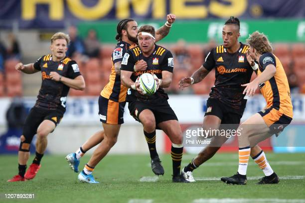 Bradley Slater of the Chiefs is tackled during the round four Super Rugby match between the Chiefs and the Brumbies at FMG Stadium on February 22,...