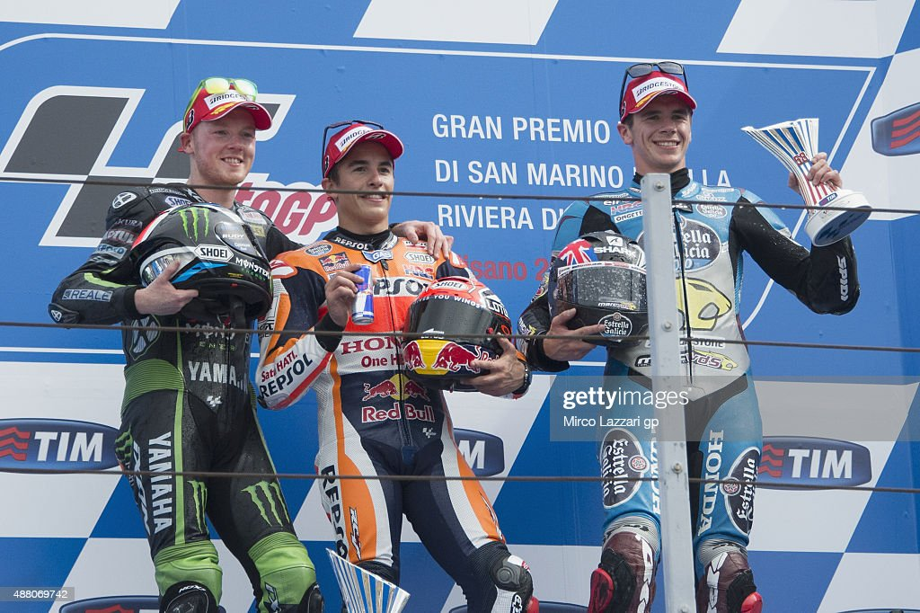Bradley Smith of Great Britain and Monster Yamaha Tech 3, Marc Marquez of Spain and Repsol Honda Team and Scott Redding of Great Britain and Estrella Galicia 0,0 Marc VDS celebrate on the podium at the end of the MotoGP World Championship race during the San Marino GP at Misano World Circuit on September 13, 2015 in Misano Adriatico, Italy.