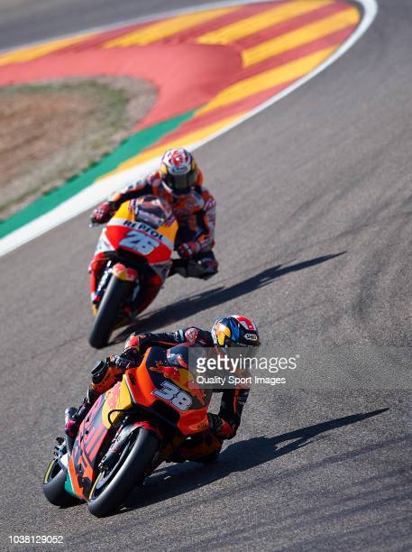 Bradley Smith of Great Britain and Red Bull KTM Factory Racing leads the group during the MotoGP of Aragon Qualifying at Motorland Aragon Circuit on...