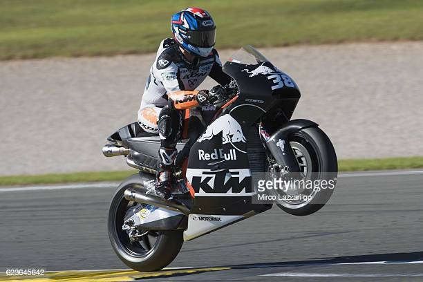 Bradley Smith of Great Britain and Red Bull KTM Factory Racing lifts the front wheel during the MotoGp Tests In Valencia at Ricardo Tormo Circuit on...