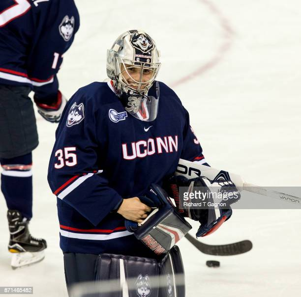 Bradley Stone of the Connecticut Huskies warms up before a game against the Boston College Eagles during NCAA hockey at Kelley Rink on November 7...