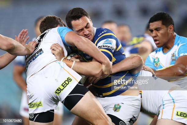 Bradley Takairangi of the Eels is tackled by the Titans defence during the round 21 NRL match between the Parramatta Eels and the Gold Coast Titans...