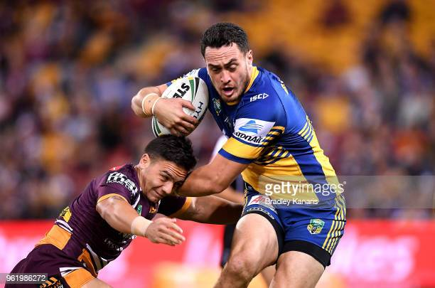 Bradley Takairangi of the Eels takes on the defence of Kodi Nikorima of the Broncos during the round 12 NRL match between the Brisbane Broncos and...