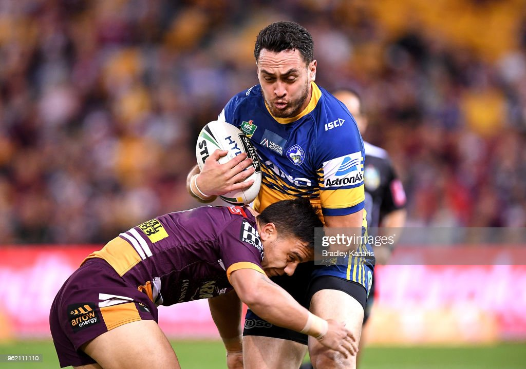 Bradley Takairangi of the Eels takes on the defence of Kodi Nikorima of the Broncos during the round 12 NRL match between the Brisbane Broncos and the Parramatta Eels at Suncorp Stadium on May 24, 2018 in Brisbane, Australia.