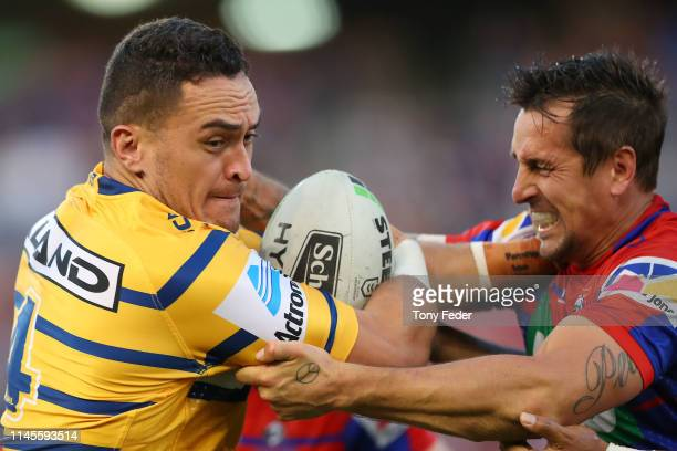 Bradley Takairangi of the Parramatta Eels is tackled by Mitchell Pearce of the Newcastle Knights during the round 7 NRL match between the Newcastle...