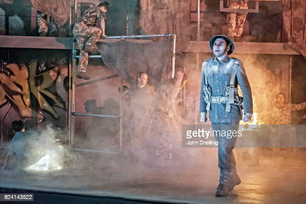 """Bradley Travis as Siegfried Sassoon with the Company perform on stage during a performance of """"Silver Birch"""" a new opera by Roxanna at Garsington..."""