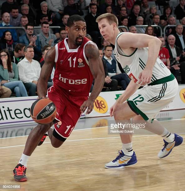Bradley Wanamaker, #11 of Brose Baskets Bamberg competes with Brock Motum, #12 of Zalgiris Kaunas during the Turkish Airlines Euroleague Basketball...